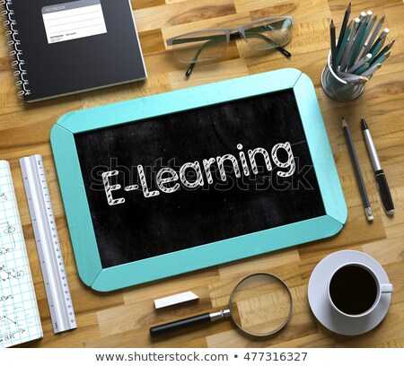 Small Chalkboard with E-Learning Concept. 3D Illustration. Stock photo © tashatuvango