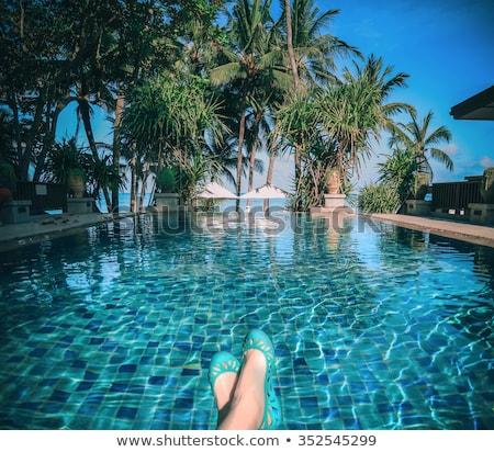 Lányok lábak úszómedence kint élvezetes lány Stock fotó © bezikus