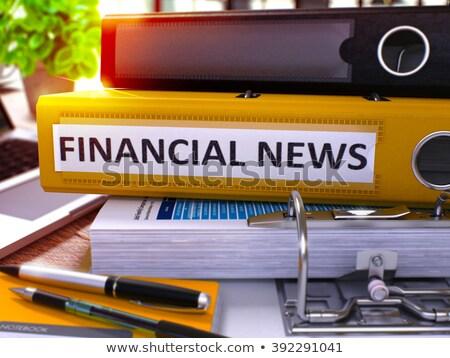 Financial News on Yellow Ring Binder. Blurred, Toned Image. Stock photo © tashatuvango