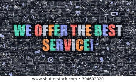 Multicolor We Offer the Best Service on Dark Brickwall. Doodle  Stock photo © tashatuvango