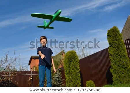 Young caucasian pilot with the model of airplane. Stock photo © RAStudio