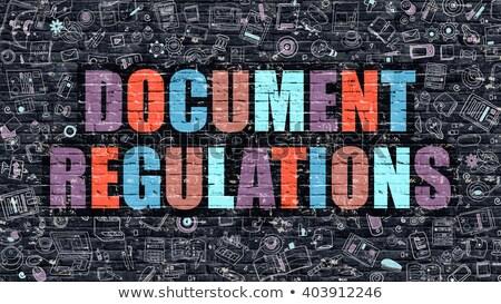 document regulations on dark brick wall stock photo © tashatuvango