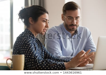 Business woman helping trainee Stock photo © IS2