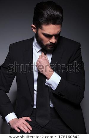 Glimlachend jonge moderne man smoking vergadering Stockfoto © feedough