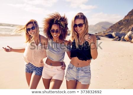 девушки берега стилизованный полосатый футболки Hat Сток-фото © tracer