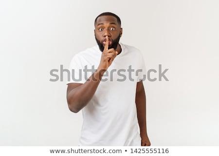 Homem provérbio calma dedo lábios Foto stock © stevanovicigor
