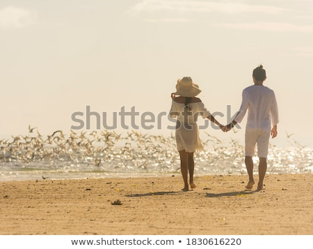Couple on sandbar. Stock photo © iofoto