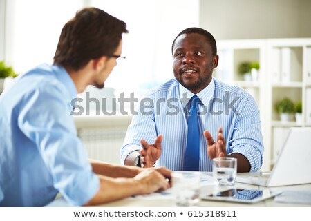 Businessman And Colleague Holding Laptop And Digital Tablet Stock photo © Pressmaster