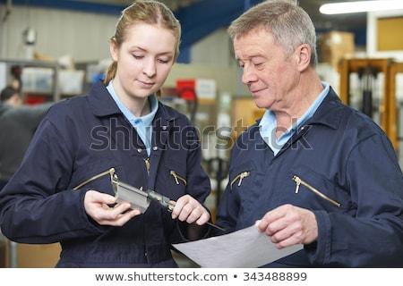 Two machinists working on machine Stock photo © monkey_business