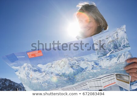 Woman reading piste map Stock photo © IS2
