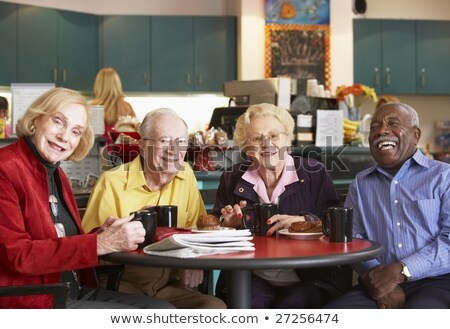Senior adults having morning tea together Stock photo © monkey_business