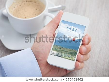 Telefon pil beyaz yalıtılmış iş Stok fotoğraf © OleksandrO