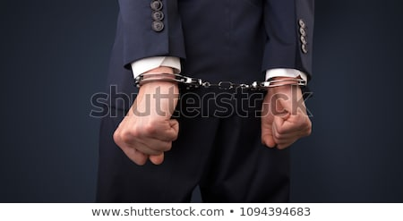 Arrested man with balance on the background Stock photo © ra2studio
