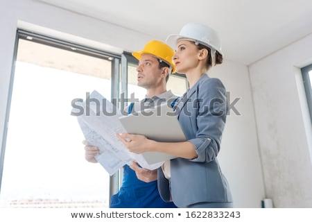 Projet propriétaire travailleur de la construction acceptation qualité travaux Photo stock © Kzenon