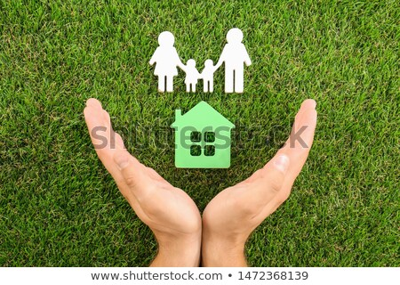 Person Protecting House With Family Figures Stock photo © AndreyPopov
