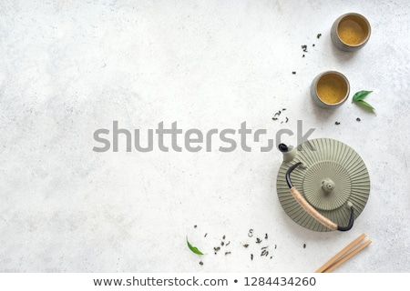 Stock photo: Asian green tea set on bamboo mat
