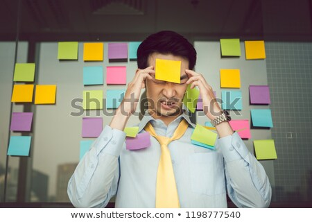 Worried businessman with adhesives notes on his body Stock photo © Kzenon