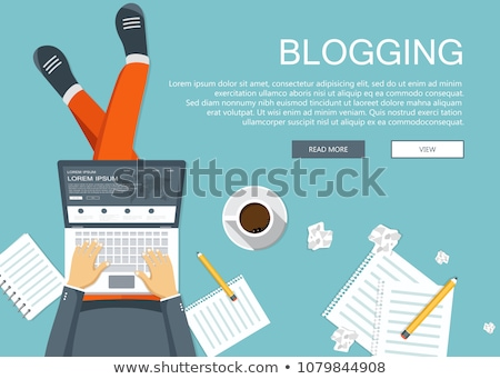 Writing a story or column for newspaper or magazine. Man sitting on the floor and holding lap top in Stock photo © makyzz