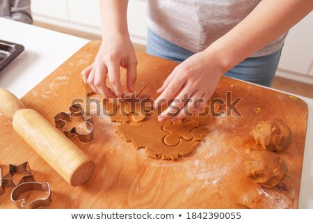 young man making a gingerbread house Stock photo © nito