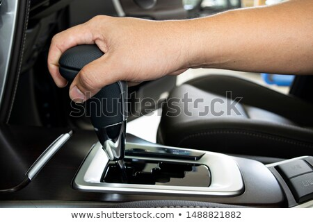 hand on automatic gear shift, Man hand shifting an automatic car Stock photo © sarymsakov