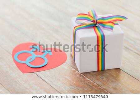 gift with gay awareness ribbon and mars symbol Stock photo © dolgachov