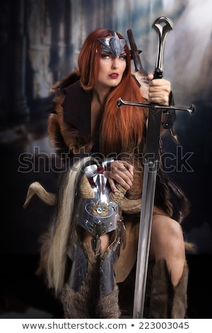 Portrait of warrior woman in image of viking with horned helmet  Stock photo © Stasia04