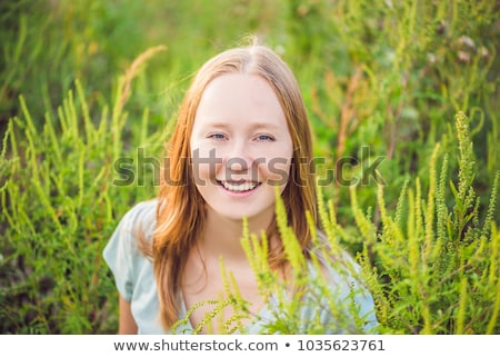 Young woman happy because no longer feels allergic to ragweed Stock photo © galitskaya