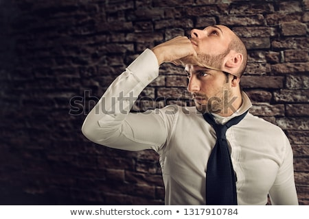 Businessman with multiple personality changes the mask Stock photo © alphaspirit