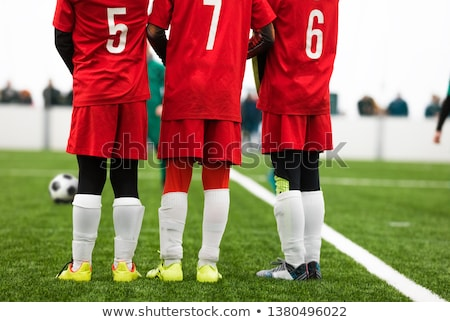 Young Footballers Standing in Wall Soccer Wall During Free Kick stock photo © matimix