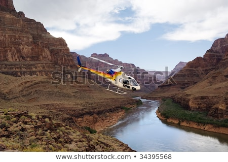 Helicopter flying over the river Stock photo © colematt