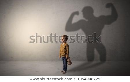 Cute nino héroe sombra detrás habitación Foto stock © ra2studio