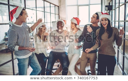 happy team celebrating christmas at office party stock photo © dolgachov