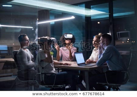 man in virtual reality headset at night office stock photo © dolgachov