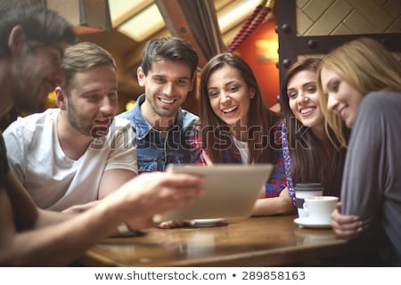 friends looking at digital tablet in the cafe stock photo © kzenon