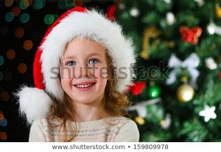 Lány mikulás kalap karácsonyfa fények ünnepek Stock fotó © dolgachov