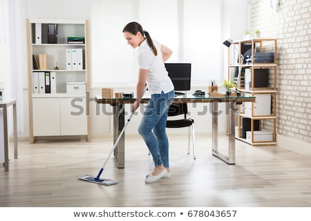 Happy Janitor Cleaning Floor With Mop Stock photo © AndreyPopov