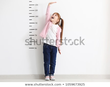 kid is measuring the growth stock photo © choreograph