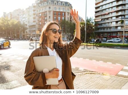 amazing happy beautiful woman holding laptop computer waving to friends stock photo © deandrobot