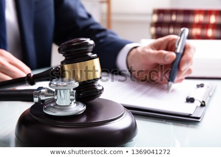mallet and stethoscope over sound block in court stock photo © andreypopov