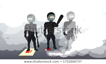 protesting african man. the rights of blacks. riot police with a baton Stock photo © studiostoks
