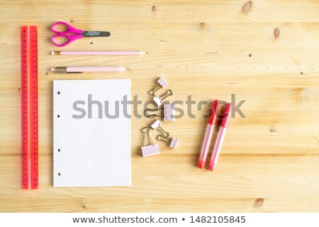 Ruler, pink scissors, pen, pencil, group of clips, notebook and two highlighters Stock photo © pressmaster