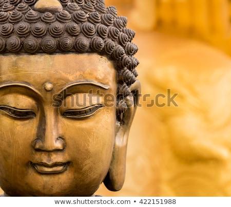 old buddhist sculpture stock photo © smithore