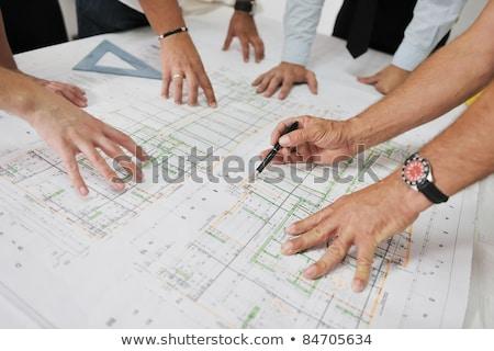 Engineers Looking At Blueprints Сток-фото © dotshock