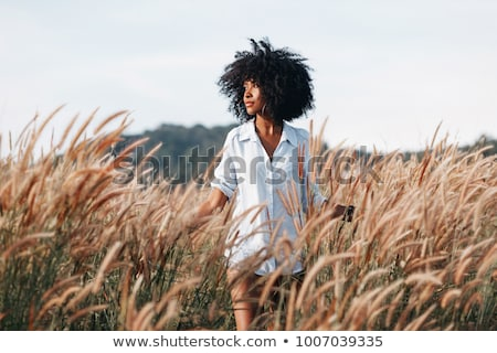 Woman in a field Stock photo © photography33