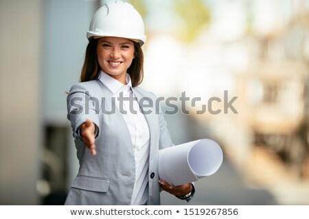 Pracownik budowlany strony na zewnątrz budowy projektu Zdjęcia stock © photography33