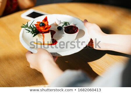 waiter giving woman cake plate at cafe stock photo © candyboxphoto