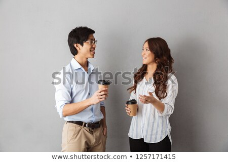 Men and women talking over drinks Stock photo © IS2