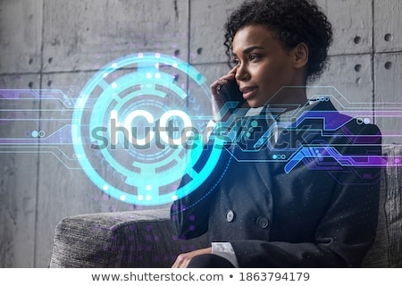 Stock photo: businesswoman with cryptocurrency holograms