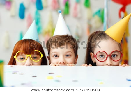 The Two adorable kids having fun at birthday party stock photo © Lopolo