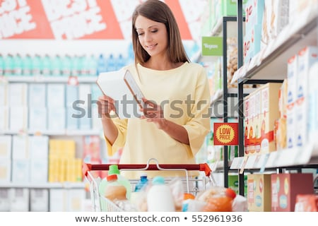 Shopping Woman Buying Products on Sale Discounts Stock photo © robuart